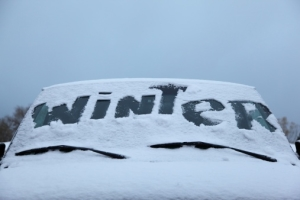 Wintertime snow writing windshield